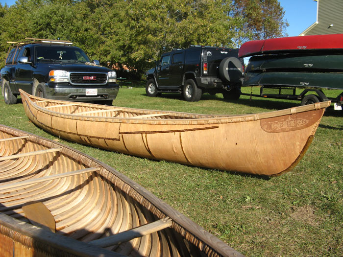 The grandmother canoe, behind a canoe built by Todd Labrador, Mi'kmaq