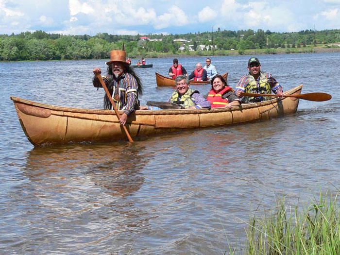 The grandmother canoe, paddled by Wayne and Kim Brooks, with Andrea Bear Nicholas riding amidships